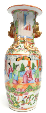 Chinese Canton vase decorated in famille rose with typical decoration and relief moulded