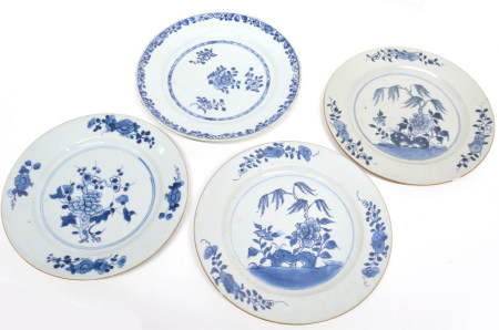 Group of four 18th century Chinese porcelain blue and white plates, all with typical decoration