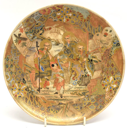 Japanese Satsuma plate decorated with figures in a landscape, 22cm diam