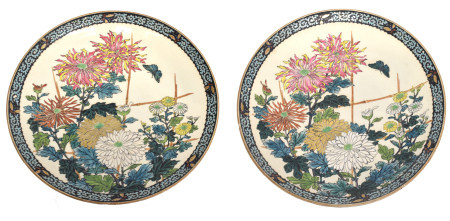 Pair of Japanese porcelain dishes decorated with floral sprays and butterflies, 36cm diam (2)
