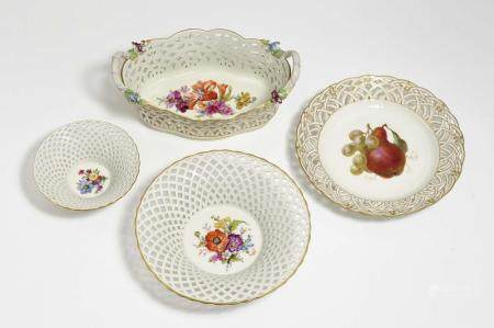 A basket with handles, two basket bowls and fruit plate with