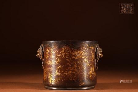 SPLASH GILT BRONZE CAST CYLINDRICAL CENSER WITH LION MASK HANDLES