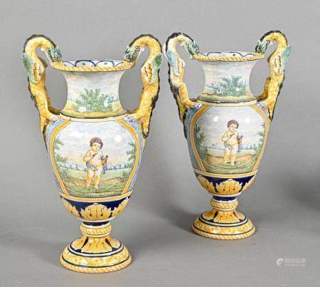 NEVERS  Paire de vases en faïence de forme balustre à deux anses en dragons ailés, reposant sur