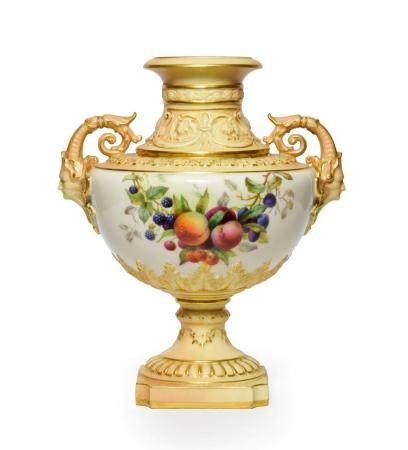 A Royal Worcester Porcelain Vase, 1904, of urn form with mask and scroll handles, painted with a