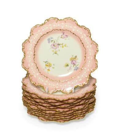 A Set of Twelve Royal Crown Derby Porcelain Dessert Plates, 1895, painted with scattered