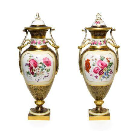 A Pair of Copeland Porcelain Vases and Covers, circa 1910, of urn shape with twin scroll handles,