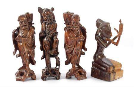 3 Asian wooden bombarded statues of men 30.5 cm and 33.5 cm high and kneeling figure 27.5 cm high (