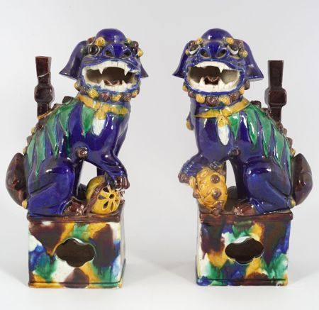 PAIR OF CHINESE POLYCHROME STONEWARE FO DOGS