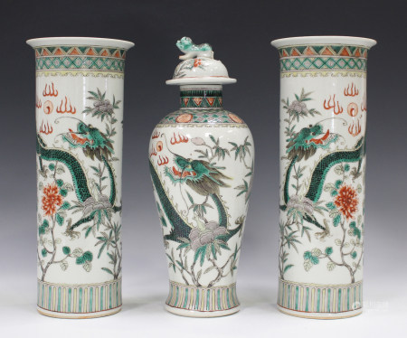 A Chinese famille verte porcelain garniture of three vases, mark of Kangxi but late 19th century,