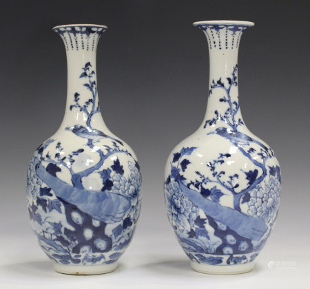 A pair of Chinese blue and white porcelain bottle vases, late 19th century, each ovoid body and
