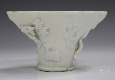 A Chinese blanc-de-Chine porcelain libation cup, probably Kangxi period, of traditional horn form,
