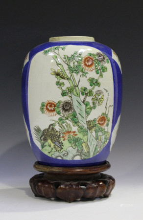 A Chinese famille verte and powder blue ground porcelain vase, late 19th century, of ovoid form,