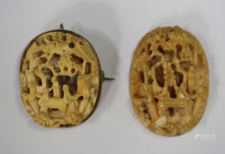 A Chinese Canton export ivory oval panel, carved in relief with figures in a village scene, with 9ct