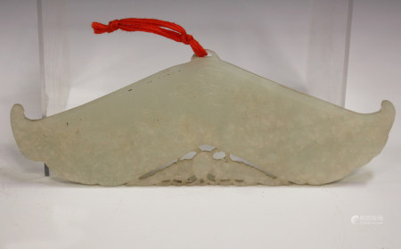 A Chinese pale celadon jade chime pendant (huang), late Qing dynasty/early 20th century, each side