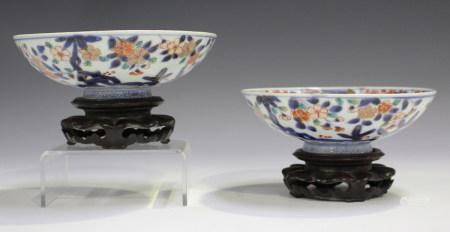 A pair of Japanese Imari porcelain hemispherical porcelain bowls, 18th century, each exterior
