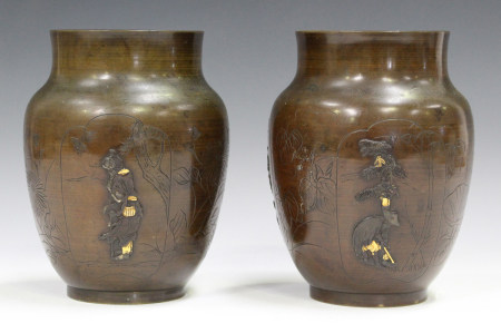A pair of Japanese brown patinated bronze vases, Meiji period, each of swollen ovoid form, decorated