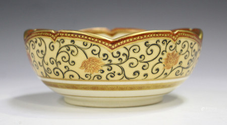 A Japanese Satsuma earthenware circular bowl with scalloped rim, Meiji period, painted to the