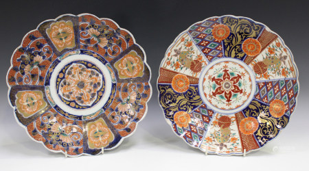 Two Japanese Imari porcelain circular dishes, Meiji period, one with panels of moths and butterflies
