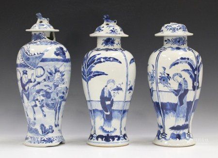 A pair of Chinese blue and white porcelain vases and covers, mark of Kangxi but late 19th century,