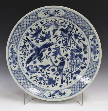 A Chinese blue and white porcelain circular dish, late 19th century, painted with magpies amidst