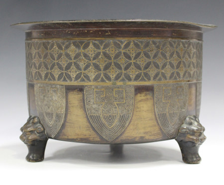 A Chinese bronze circular cylindrical censer, 20th century, the sides cast with cash diaper band