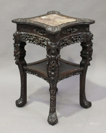 A Chinese hardwood two-tier stand, late Qing dynasty, the top inset with a rouge marble panel within