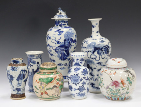 A Chinese blue and white porcelain baluster vase, mark of Kangxi but late 19th century, painted with