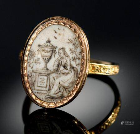 A GOLD MOURNING RING, 1779 set with an oval miniature painted en grisaille with a lady seated beside