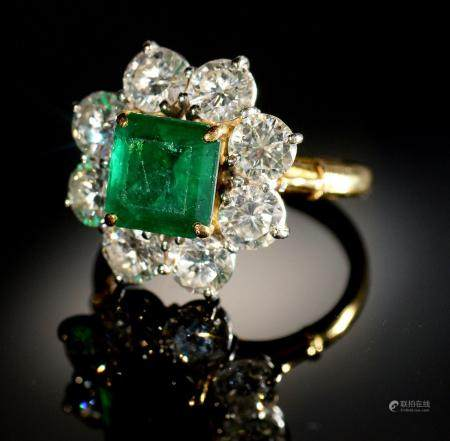 AN EMERALD AND DIAMOND RING,  with step cut emerald of approx 6 x 6mm and of approx 2ct, in a