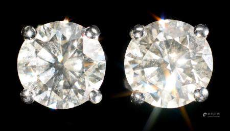 A PAIR OF DIAMOND EAR STUDS   each round brilliant cut diamond of approx 1.5ct each, 8mm, Birmingham