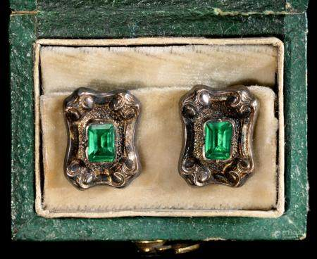 A PAIR OF FRENCH FOILED GREEN PASTE, SILVER AND GOLD DRESS STUDS, 19TH C  10 x 13mm, tete d'aigle