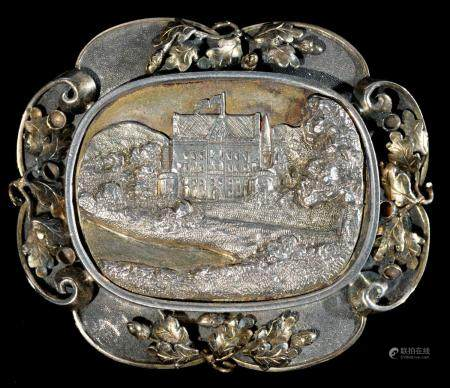 ROYAL.  A PARCEL GILT SILVER BROOCH with cast oblong engraved bas relief view of a schloss, possibly