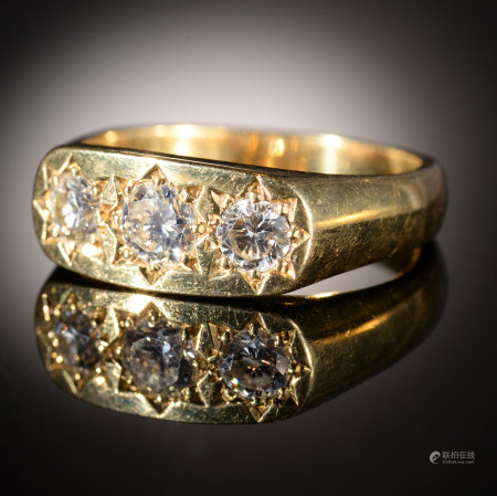 A DIAMOND RING gipsy set with three modified round brilliant cut diamonds, in 18ct gold, London