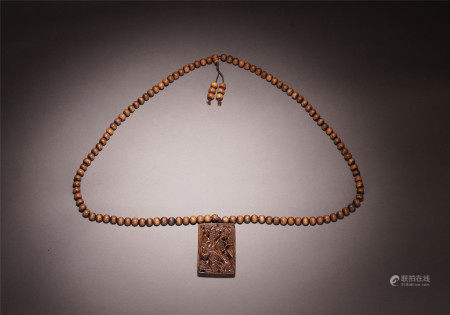 A CHINESE CARVED PINE BAMBOO PLUM BLOSSOM PATTERN AGARWOOD ABSTAINANCE PLAQUE AND BEADS NECKLECK