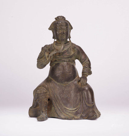 A CHINESE BRONZE WARRIOR SEATED STATUE