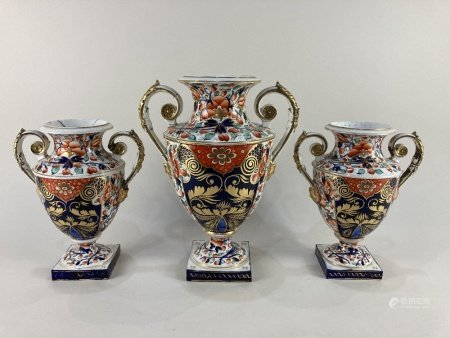 A 19th century Derby porcelain baluster urn, decorated in the Imari pattern, the two scroll
