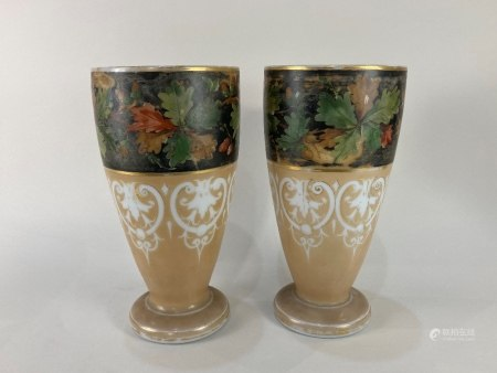A pair of Victorian painted glass vases, with oak leaf and acorn design on black ground, above