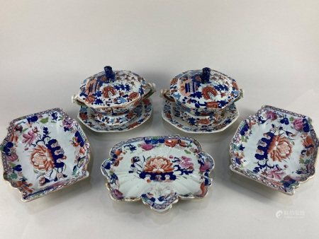 A pair of 19th century Imari pattern stoneware sauce tureens, covers and saucers, with fo dog