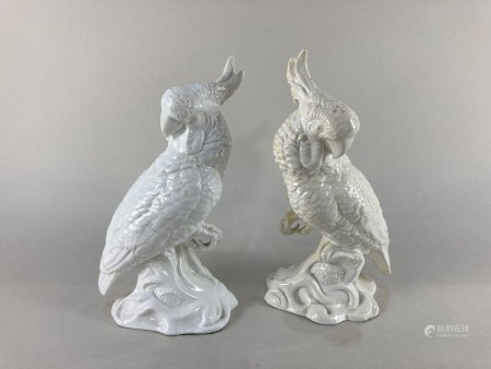 A pair of Crown Staffordshire porcelain models of cockatoos, designed and modelled by J. T.