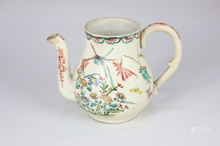 A small pottery teapot, possibly 18th century, decorated with flowers and insects on cream
