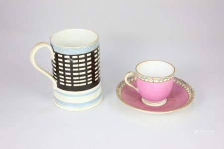 An 18th /19th century teacup and saucer, possibly Worcester, of ribbed form, decorated in pink