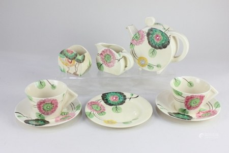 An Art Deco Clarice Cliff Newport pottery 'Bonjour' part breakfast set for two, decorated with a