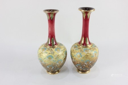 A pair of Doulton Lambeth 'Slaters patent' stoneware bottle vases, each decorated with blue and