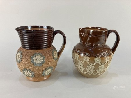 Two Doulton Lambeth pottery jugs, one with overlaid floral design by Annie Partridge, the other with
