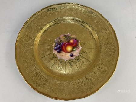A Royal Worcester porcelain cabinet plate, with central hand painted fruit design, signed Freeman,