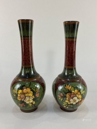 A pair of Victorian Doulton Lambeth pottery bottle vases by Mary Mitchell, with floral spray