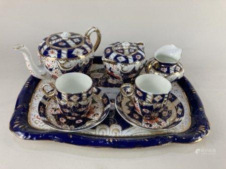 A Sandland Imari pattern porcelain cabaret tea set, comprising teapot, sugar bowl and cover, milk