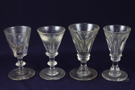 Four various early 19th century wine or spirit glasses, each with deceptive bowl, on knop stem,