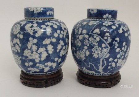 TWO CHINESE BLUE AND WHITE GINGER JARS AND COVERS each painted with blossoming branches on a clouded