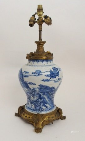 A CHINESE TRANSITIONAL BALUSTER VASE painted with a winged dragon, shishi and birds of prey on